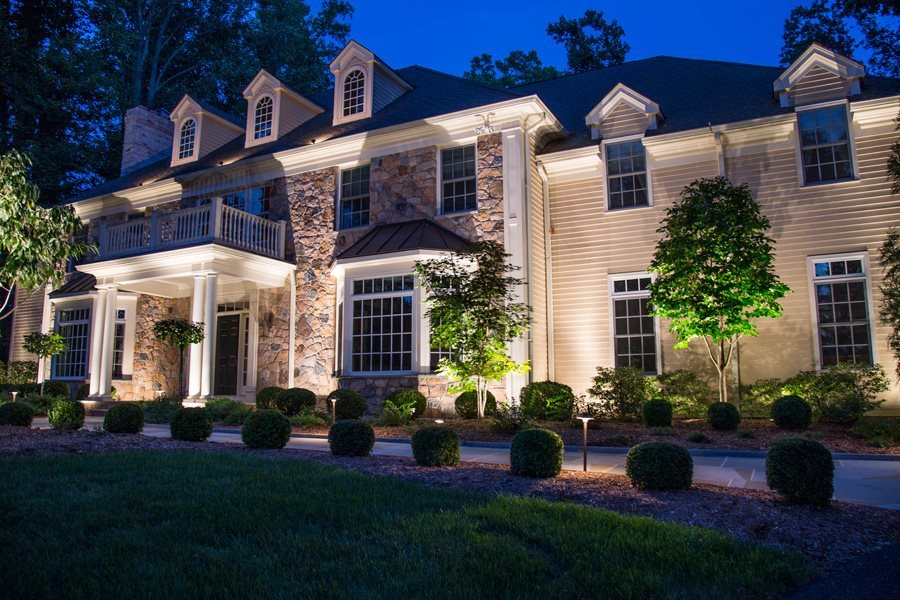 Outdoor Lighting Illuminates Home and Front Walk