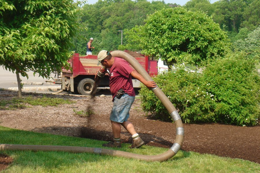 Blowing Mulch into Garden Bed