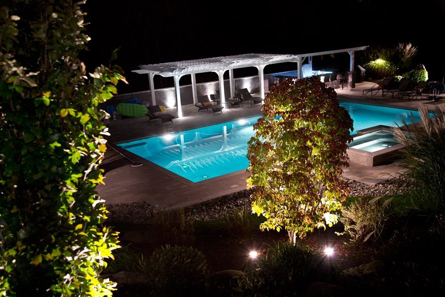 Illuminated Plantings Surrounding Swimming Pool